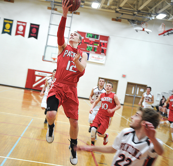 Austin's Zach Wessels goes up for a late-game lay-up against Winona Tuesday night in Packer Gym. The layup put Wessels just one point away from 1,000 points.