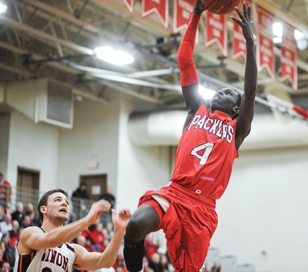 Austin's Ajuda Nywesh gets a layup in the first half against Winona Tuesday night in Packer Gym.