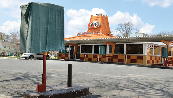 Spring moves toward summer, yet the covers remain on the ordering stations at A&W All-American Food in Austin. Owner Gregg Johnson announced Tuesday it has closed for good. -- Eric Johnson/photodesk@austindailyherald.com