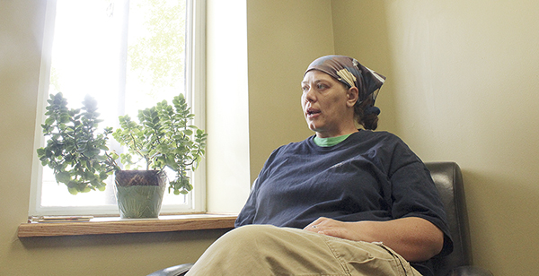 Deanna Jean discusses medical marijuana at the Austin Daily Herald office in June.