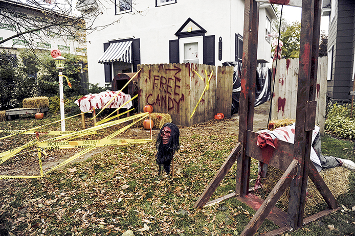 A sign for free candy sits in the middle of a grisly display at the Levi Korfhage home Halloween night. -- Eric Johnson