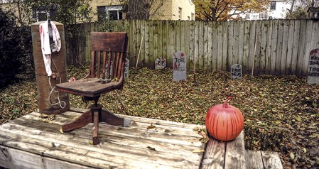 Tombstones are spread out throughout the backyard