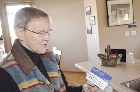 Mary Hokanson shows off a refridgerator magnet with Mayo Clinic Health System's hospice care number. Hokanson said the number was a huge help when her husband, Jim, entered hospice care last year.