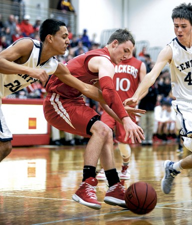 Austin's Zach Wessels scrambles after a loose ball during the first half against Rochester Century in Packer Gym. Eric Johnson/photodesk@austindailyherald.com