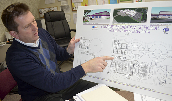 Grand Meadow Principal Paul Besel points out features to a potential physical education community complex Tuesday. Grand Meadow Public Schools will ask the public to support a $13.7 million referendum for additional space and school renovations next month. Trey Mewes/trey.mewes@austindailyherald.com
