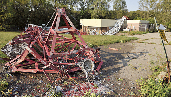 The very top of KSMQ's transmitter tower laid partially on the parking lot in the southwest corner of the Riverland Community College west campus in September of 2012. The tower, owned by KSMQ, fell at around midnight as powerful storms swept through the area. Herald file photo
