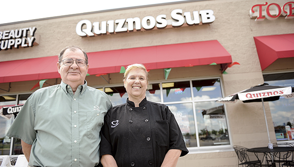 Norm and Marlene Blaser stand outside the Quinzos they own in the Target strip mall Tuesday morning. The couple may be closing the restaurant at the end of August unless they can find a buyer. The Blasers are planning on retiring. Eric Johnson/photodesk@austindailyherald.com