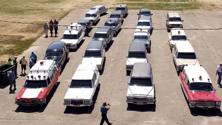 Twenty-eight hearses and ambulances sit parked together at the Mower County Fairgrounds Thursday. The vehicles and their owners are part of the Professional Car Society.