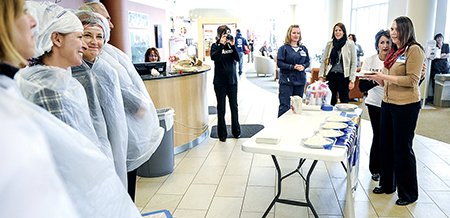 Erin Evenson gets some coaching from Tori Miller as she eyes up who gets the first pie in the face Wednesday at the Mayo Clinic Health Systems - Austin.