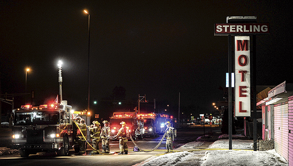 Austin firefighters pack up gear after extinguishing a fire at the Sterling Motel Tuesday night. -- Eric Johnson/photodesk@austindailyherald.com