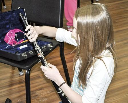I.J. Holton sixth-grader Siri Ansorge puts together her oboe before band practice Friday morning.  Jenae Hackensmith/jenae.hackensmith@austindailyherald.com