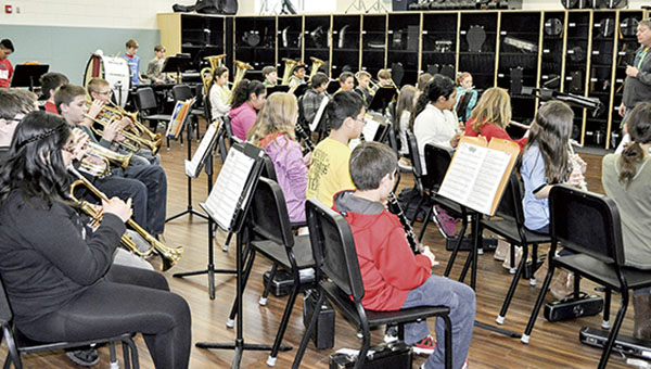 """One of the sixth-grade band sections practices """"When the Saints Go Marching in"""" Friday morning at I.J. Holton Intermediate School. There are several sections of both fifth- and sixth-grade bands due to the increasing number of students and limited space and one-on-one teacher/student time. Jenae Hackensmith/jenae.hackensmith@austindailyherald.com"""