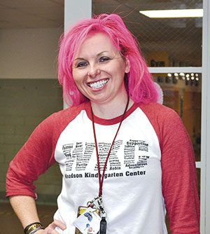 Woodson Kindergarten Principal Jessica Cabeen gets her hair sprayed pink after the kindergarten critters third year of collecting pennies raised $1,700 for Paint the Town Pink cancer research. Jenae Hackensmith/jenae.hackensmith@austindailyherald.com