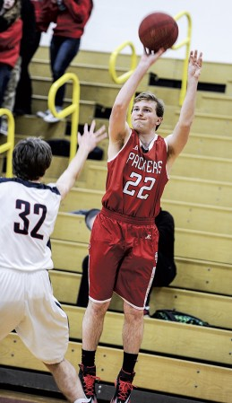 Austin's Connor Bollum pops a three from the corner during the first half against Albert Lea Tuesday night in Packer Gym. Eric Johnson/photodesk@austindailyherald.com