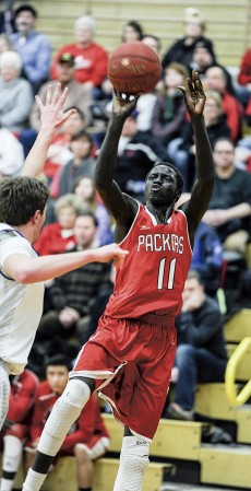 The Packers Gach Gach puts up a fade-away as Austin took on Owatonna Friday night in Packer Gym. Eric Johnson/photodesk@austindailyherald.com