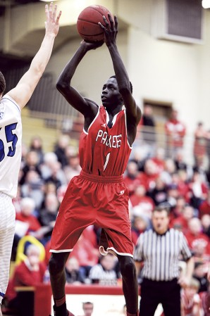 Austin's Both Gach gets a look in the lane during the first half against Owatonna Friday night in Packer Gym. Eric Johnson/photodesk@austindailyherald.com
