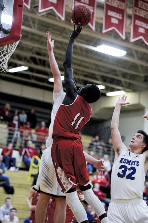 Austin's Gach Gach puts up a shot in the first half of the Packers Section 1AAA playoffs against Kasson-Mantorville Wednesday night in Packer Gym. Eric Johnson/photodesk@austindailyherald.com