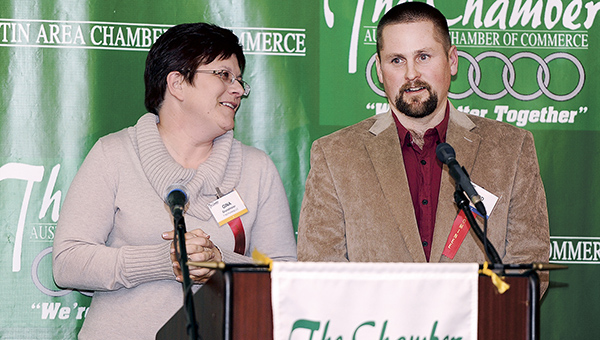 Todd and Gina Grundmeier accept their award after being named Business of the Year during the annual Chamber Banquet Thursday night at the Holiday Inn Convention Center. Eric Johnson/photodesk@austindailyherald.com