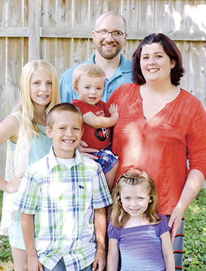 A benefit will be held Saturday for the Mergen family to help buy a seizure dog for 1-year-old Adrian. Pictured, from left in the front row are Gavin and Taya; in the middle row are Alizha, Adrian and Sarah; and Kyle is in the back.  Photo provided by Kristina Matheis
