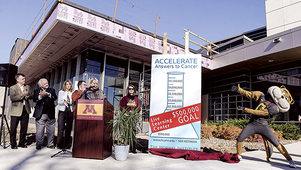 With the help of Goldy the Gopher, The Hormel Institute announced Saturday afternoon a grant from the University of Minnesota of $1.5 million for the institute's Live Learning Center. - Photos by Eric Johnson/photodesk@austindailyherald.com