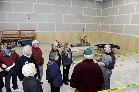 The Hormel Institute's Tim Ruzek guides a group through the still under construction Live Learning Center Saturday afternoon following an announcement that the University of Minnesota gave $1.5 million to the institute project.
