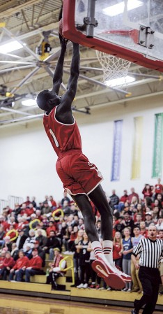 Austin guard Both Gach throws down Tuesday night in the first half against Kasson-Mantorville in Packer Gym. Eric johnson/photodesk@austindailyherald.com