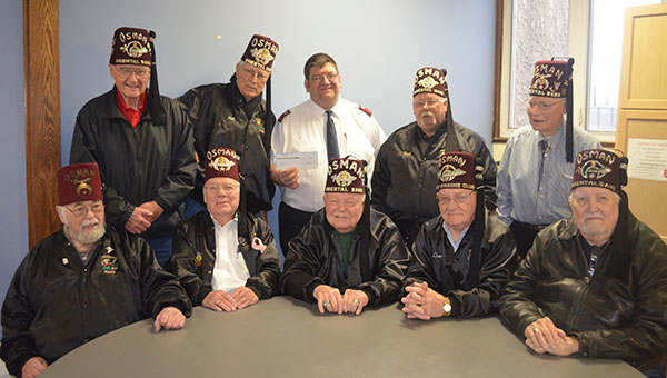 The Austin Area Shrine Club & Oriental Band collected $7,240, which was matched by the Minnesota Masonic Charities, resulting in a $14,480 donation to the Salvation Army Tuesday. From left, front row: Dave Madison, Max Pecht, Norm Hecimovich, Charles VanHouse, Bill Newell. Back row: Malcolm McDonald, Neil Hanson, Lt. Dave Amick, Brad Stout, Les Buck. Jenae Hackensmith/jenae.hackensmith@austindailyherald.com