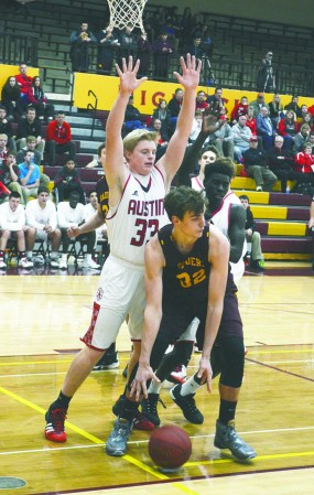 Austin's Kyle Oberbroeckling plays defense in Northfield Tuesday. Rocky Hulne/sports@austindailyherald.com