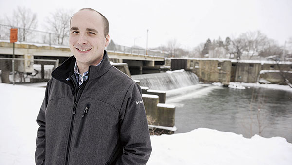 Tim Ruzek stands next to the Fourth Avenue NE bridge. Ruzek, who was previously with The Hormel Institute has now been hired by the Mower County Soil and Water Conservation District and Cedar River Watershed District. Eric Johnson/photodesk@austindailyherald.com