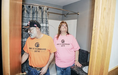 Becky and Gary Josephson look over their new bathroom after the big reveal Friday evening from this year's T 'N G Plumbing Pay It Forward event.  Eric Johnson/photodesk@austindailyherald.com