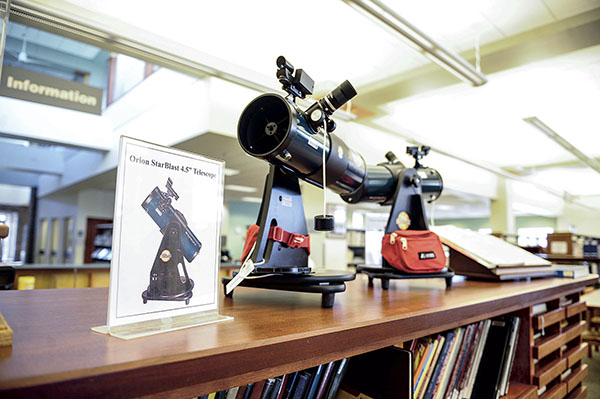 A pair of telescopes sit out on display at the Austin Public Library. The newly acquired telescopes are now available to be checked out. Eric Johnson/photodesk@austindailyherald.com