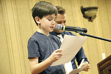 """Max Larson of Southgate Elementary School reads his poem Monday at the Richard Eberhart """"A Night with our Poets"""" at the Hormel Historic Home."""