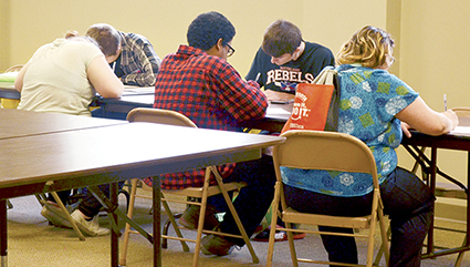 Students fill out job applications during an event at St. Olaf Lutheran Church to help transition them into the workforce after high school on Wednesday.