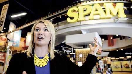 Nicole Behne, marketing director for grocery products, shows off the new Can Central that will greet visitors to the new Spam Museum. Photos by Eric Johnson/photodesk@austindailyherald.com