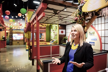 Nicole Behne, marketing director for grocery products for Hormel, talks about the World Market, new to the Spam Museum. Eric Johnson/photodesk@austindailyherald.com