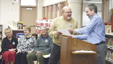 Ron Howard accepts an award recognizing his volunteer work at Banfield Elementary School on April 5.
