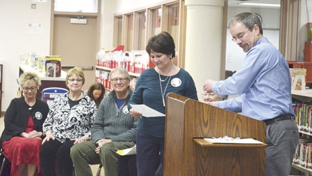 Kathy Howard accept an award recognizing her volunteer work at Banfield Elementary School on April 5.
