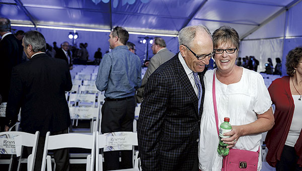 Gary Ray, left, and Darci Buchan, right, talk during The Hormel Institute expansion celebration and grand opening Wednesday. Eric Johnson/photodesk@austindailyherald.com