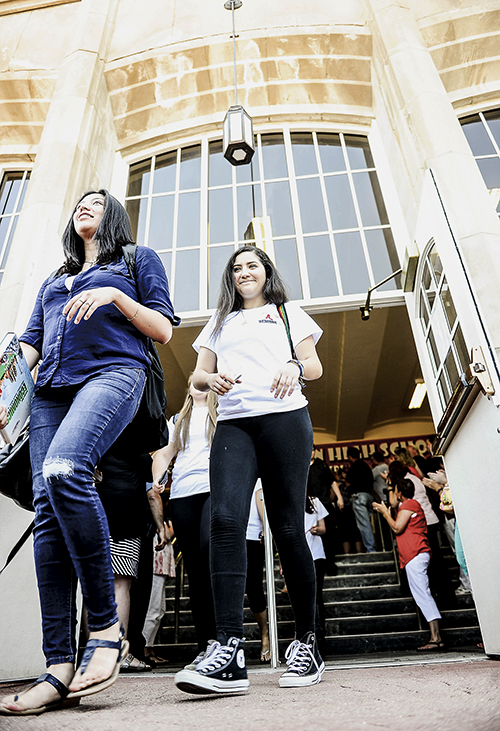 Seniors head out the doors of Austin High School during the senior's final walkthrough Tuesday afternoon.