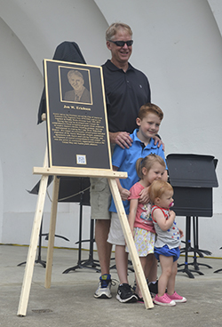 Jon Erichson, one of the Pillars of the City recipients, poses for a photo with his grandchildren Noah, Jade and Emmy Monday afternoon at Bandshell Park.