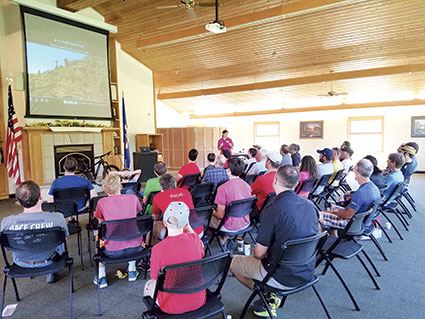 Volunteers take part in a morning education session in the Ruby Rupner Auditorium at the Jay C. Hormel Nature Center. Photos provided