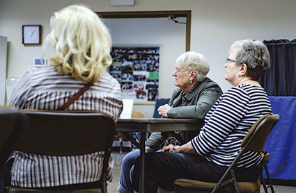 A group of people listen to Jerry Roseblad of Humana Health Insurance as he gives a seminar on getting the most out of a doctor's visit Thursday at the Mower County Senior Center.