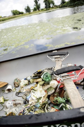 Collected garbage rests in the bottom of a canoe at Mill Pond. Eric Johnson/photodesk@austindailyherald.com