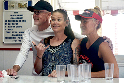 Tendermaid owners Sara and Gary White pose with Molly Schuyler, center, after she beat the Tendermaid challenge.