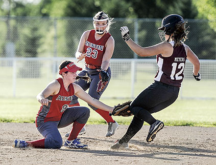 Austin 16U shortstop Lily Riddles puts the tag on for the out against Triton.