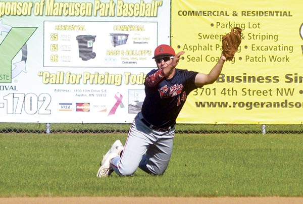 AJ Mueller stretches out to make a catch in right field for the Austin Post 1216 VFW baseball team against Mantorville in Marcusen Park Monday. Rocky Hulne/sports@austindailyherald.com