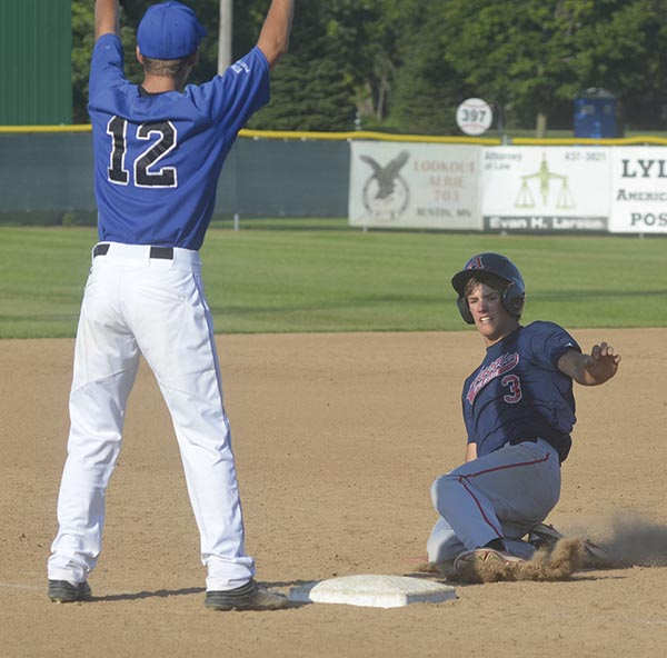 Austin's Riley Wempner slides into third base against Rochester Century in Marcusen Park Tuesday. Rocky Hulne/sports@austindailyherald.com