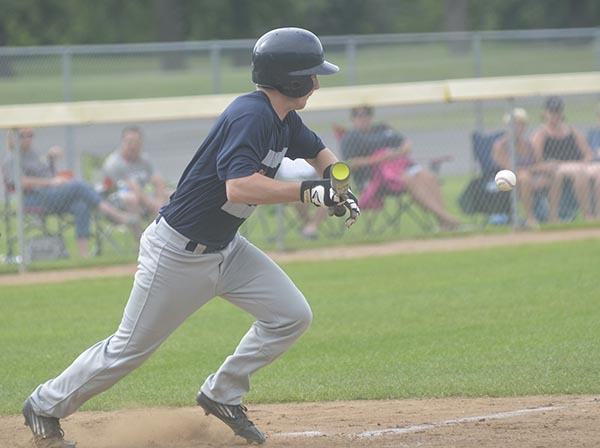 Nate Conner bunts for Austin Post 91 against Winona in Marcusen Park Tuesday. Rocky Hulne/sports@austindailyherald.com