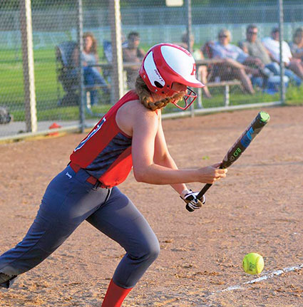 Austin's Adison Medgaarden lays down a bunt against Dover-Eyota in Todd Park Monday. Rocky Hulne/sports@austindailyherald.com