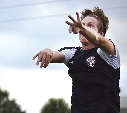 Corbin Munger does a throw for the Austin U17 boys during the section finals game of the Division C3 State Soccer Tournament in Mankato Thursday against Coon Rapids.